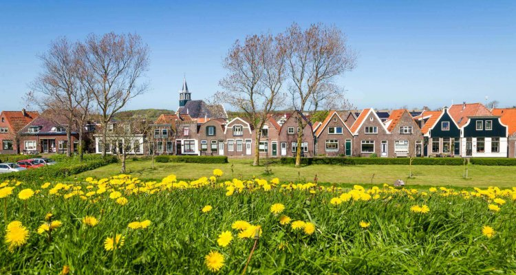 Panorama Village Oudeschild with Zeemans church and trraditional gable  houses on the Wadden island Texel in the Netherlands